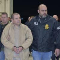 Mexican drug baron Joaquin 'El Chapo' Guzman, one of the world's most notorious criminals, is extradited to the United States to face charges. U.S. prosecutors on Wednesday called for the 'ruthless' drug lord to be jailed for life plus 30 years.. | HO / US DEPARTMENT OF JUSTICE / VIA AFP-JIJI