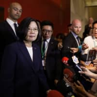 China says it will freeze out U.S. companies that sell arms to Taiwan
