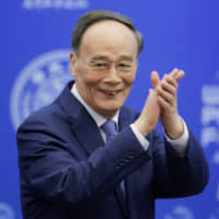 In jab at U.S., Chinese Vice President Wang Qishan says world cannot shut Beijing out