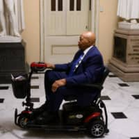Democratic U.S. Rep. Elijah Cummings for Maryland goes to the house chambers before the Democrat controlled House of Representatives passed a resolution condemning President Donald Trump for his 'racist comments' about four Democratic congresswomen the day before, at the Capitol in Washington Tuesday. | AFP-JIJI