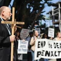 Father Chris Ponnet, leader of the St. Camillus Center in Los Angeles, speaks during a rally protesting against the death penalty and in favor of immigration reform in Anaheim, California, in 2017. | REUTERS