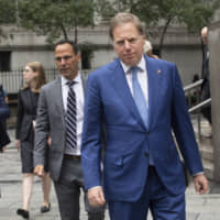 Geoffrey Berman (front), the United States attorney for the Southern District of New York, leaves federal court in New York after a judge denied bail to Jeffrey Epstein Thursday. | AP