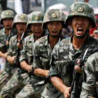 Chinese military signals it will keep Hong Kong-based troops in barracks amid protests