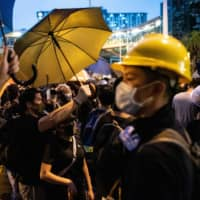 Thousands of protesters attend rally in Hong Kong suburb