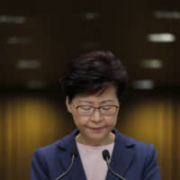 Hong Kong chief executive's departure seen as just a matter of time