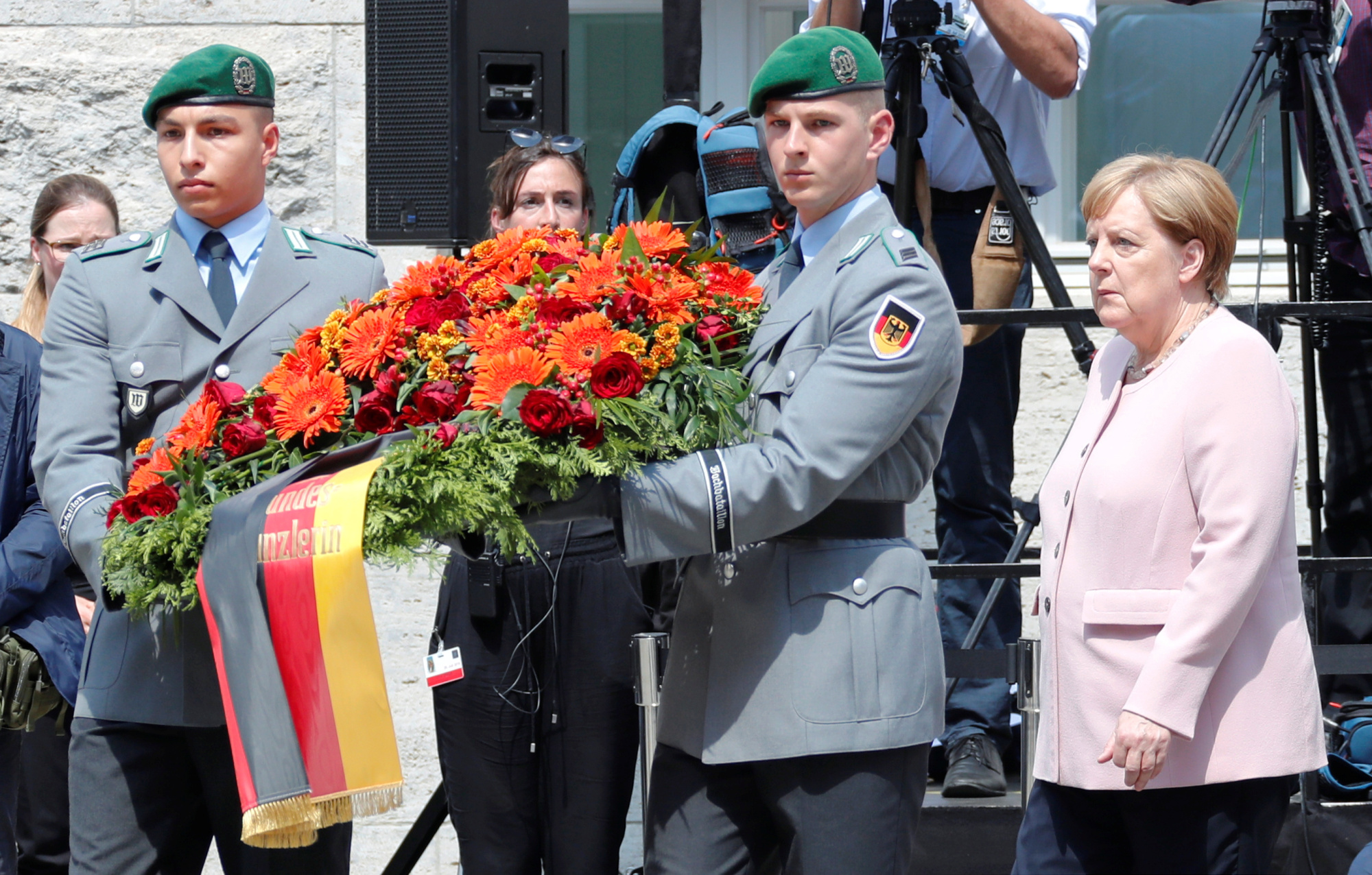 German Chancellor Angela Merkel takes part in a 75th anniversary wreath-laying ceremony at the site where officers led by Claus Schenk Graf von Stauffenberg were shot after their failed attempt on the life of Adolf Hitler, in the Bendlerblock building in Berlin on July 20. | REUTERS