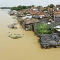 A flooded area is seen Wednesday following heavy monsoon rains in Muzaffarpur in the Indian state of Bihar. | AFP-JIJI