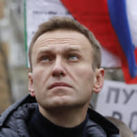 Russia opposition figure Alexei Navalny hospitalized, and may have been poisoned, says doctor