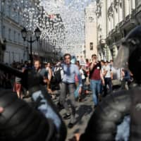 Protesters face police at a rally calling for opposition candidates to be registered for elections to Moscow's regional legislature on Saturday. | REUTERS