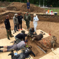 Archaeologists take part in excavation work after they discovered what they believe to be the burial site of French Gen. Charles Etienne Gudin in a park in Smolensk, Russia, in this handout picture obtained by Reuters on Tuesday. | SMOLENSK NEWSPAPER 'RABOCHY-PUT.RU' / HANDOUT / VIA REUTERS