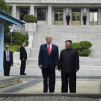U.S. President Donald Trump and North Korean leader Kim Jong Un stand on the North Korean side of the Demilitarized Zone in Panmunjom on June 30. | AP