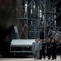 Kim inspects new submarine in first public display of North Korea's nuclear capabilities since 2017