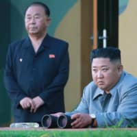 North Korea says firing of new missile was 'warning to the South Korean military warmongers'