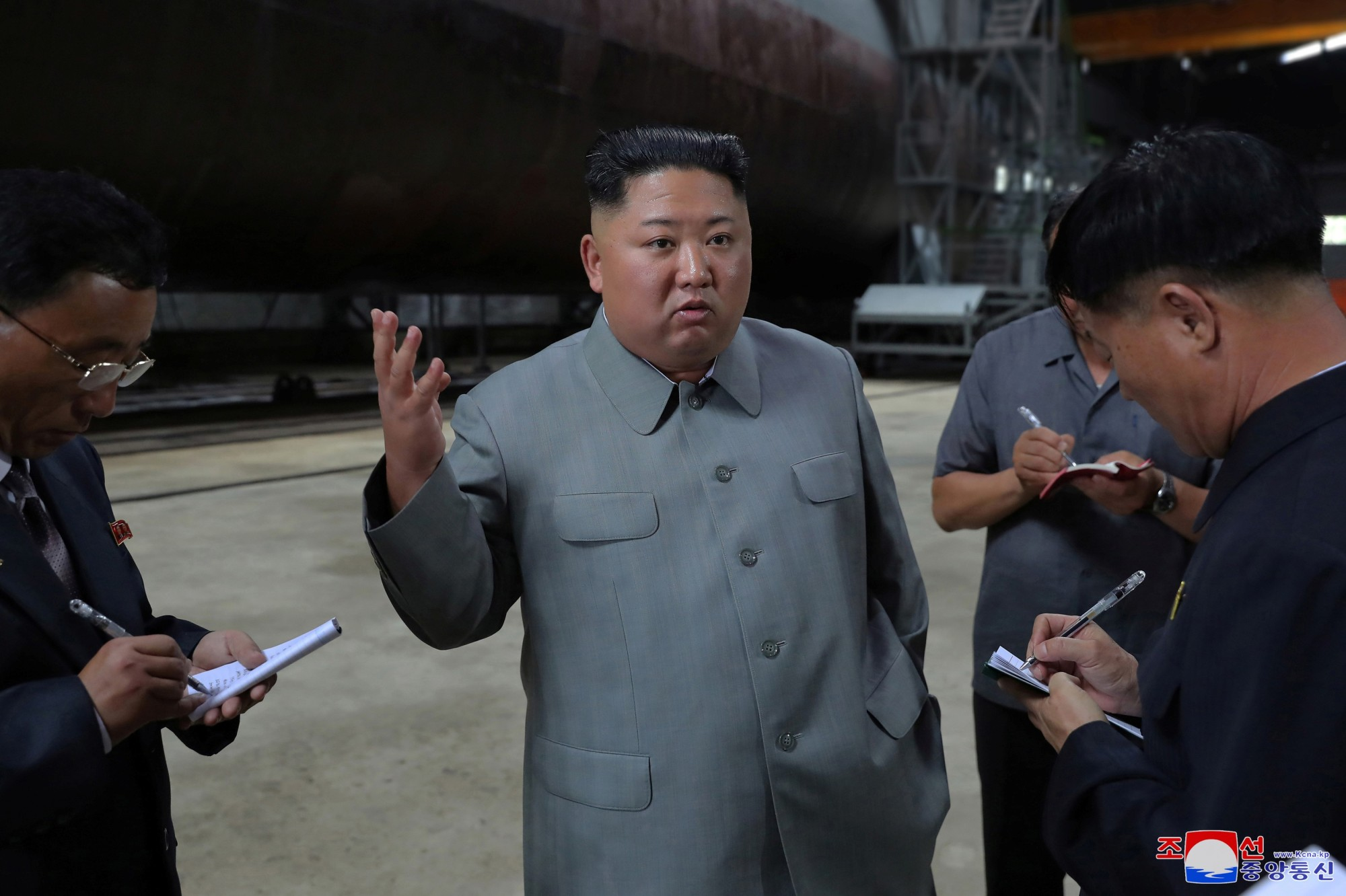 North Korean leader Kim Jong Un visits a submarine factory in an undisclosed location in North Korea in this undated picture released by North Korea's Central News Agency (KCNA) on Tuesday. The North on Wednesday reportedly fired unidentified projectiles from around Wonsan. | KCNA / VIA REUTERS