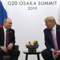 President Donald Trump (right) meets with Russian President Vladimir Putin during a bilateral meeting on the sidelines of the G-20 summit in Osaka June 28. Delegations from the U.S. and Russia are meeting this week to discuss arms control and the possibility of coaxing China into negotiating a new, three-way nuclear weapons pact, two senior administration officials said Monday. | AP