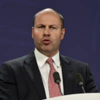 Australian Treasurer Josh Frydenberg speaks to the media during a news conference in Sydney on Friday. The Australian government released a report that recommends more regulation on the market power of multinational digital platforms.   AP