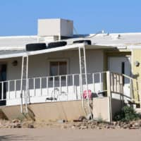 A damaged home is seen after a 6.4-magnitude earthquake hit Ridgecrest, California, on Thursday. An earthquake with a preliminary magnitude of 6.9 jolted roughly the same area late Friday. | AFP-JIJI