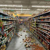 Food that fell from the shelves litters the floor at a Walmart following an earthquake in Yucca Yalley, California, on Friday | CHAD MAYES / VIA AP