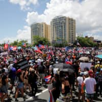 San Juan police fire tear gas to disperse protesters