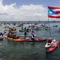 Demonstrators in kayaks gather in front of La Fortaleza for an aquatic protest against Puerto Rico Gov. Ricardo Rossello in San Juan Sunday. | AP