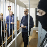 Paul Whelan, a former U.S. Marine who was arrested for alleged spying in Moscow at the end of 2018, waits for a hearing in a court in Moscow May 24. The U.S. Embassy in Moscow said on Twitter Monday that the condition of American Whelan has worsened and that the Russian authorities had rejected a request to send a doctor to examine him. | AP