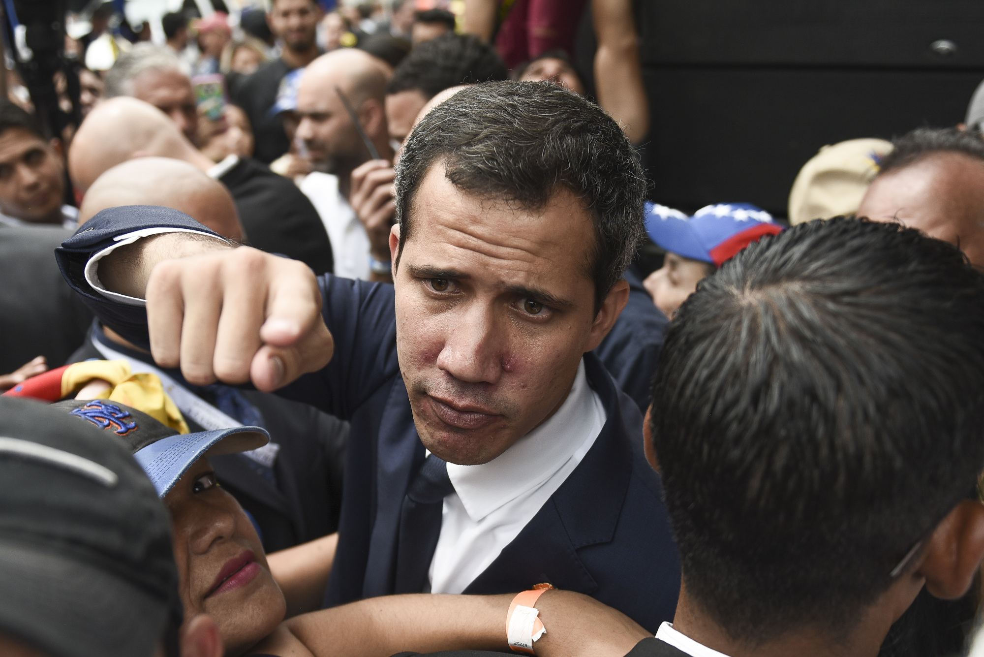 Juan Guaido, president of the National Assembly who swore himself in as the leader of Venezuela, gestures while leaving from a National Assembly session on rejoining the Inter-American Treaty of Reciprocal Assistance, known as the Rio Treaty, in the Las Mercedes neighborhood of Caracas on Tuesday. The agreement, known in Spanish as TIAR, allows for countries of the Hemisphere to request support in case of aggression.   BLOOMBERG