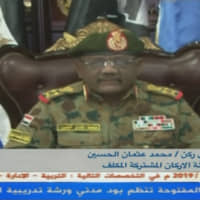 A grab from a broadcast on Sudan TV on Wednesday shows Gen. Mohamed Othman al-Hussein, the new head of the joint chiefs of staff, delivering a speech in Khartoum. Sudan's military said it had arrested a top general and several others over a foiled coup attempt announced earlier this month. The attempted coup came as the ruling military council, which took over after Omar al-Bashir's ouster in April, negotiated a power-sharing deal with protest leaders to form a joint civilian-military governing body.   SUDAN TV / VIA AFP-JIJI