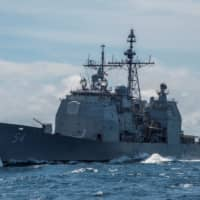 The guided-missile cruiser USS Antietam is seen in the South China Sea in March 2016. | REUTERS