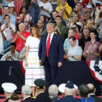 U.S. President Donald Trump and first lady Melania Trump smile during Fourth of July Independence Day celebrations in Washington Thursday.   REUTERS