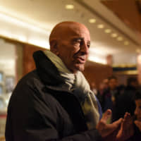 Tom Barrack speaks with members of the press at Trump Tower in New York City in January 2017. | REUTERS