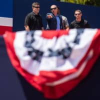 Security agents check the area as preparations are made for the 'Salute to America' Fourth of July event with U.S. President Donald Trump at the Lincoln Memorial on the National Mall in Washington Wednesday. | AFP-JIJI