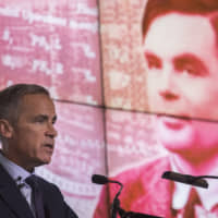 Bank of England Gov. Mark Carney announces at a news conference in Manchester, England, on Monday, that scientist Alan Turing is the person chosen for Britain's new £50 note. Turing's cracking of a Nazi code helped the Allies win World War II, | BLOOMBERG