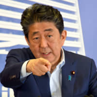 Abe vows to push forward constitutional change despite failure of pro-revision forces to win Upper House supermajority