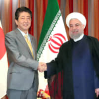 Prime Minister Shinzo Abe and Iranian President Hassan Rouhani meet at the U.N. headquarters in New York in September 2017. | KYODO