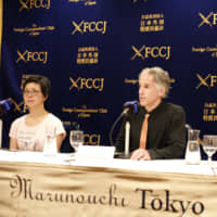 Anti-Olympic activist and former soccer player Jules Boykoff (center) speaks during a news conference in Tokyo with Misako Ichimura (left) of Hangorinnokai (No Olympics 2020) and Annie Orchier, an organizing member with NOlympics LA.   RYUSEI TAKAHASHI