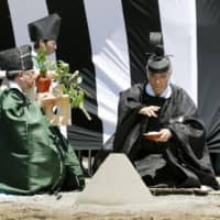 A ceremony is held on the grounds of the Imperial Palace in Tokyo on Friday to mark the start of construction of the temporary halls to be used in the Daijosai imperial succession rite in mid-November for Emperor Naruhito. | KYODO