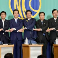 Prime Minister Shinzo Abe, who is also the Liberal Democratic Party president, and other heads of political parties participate in a debate on Wednesday at the Japan National Press Club in Tokyo. | KYODO