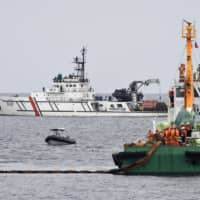 Coast guard personnel from Japan, Indonesia and the Philippines hold a drill to respond to a 'ship collision incident' in southern Philippine waters on Wednesday. | KYODO