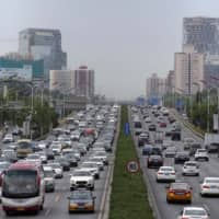 China car sales sink over chaotic adoption of new emissions rules