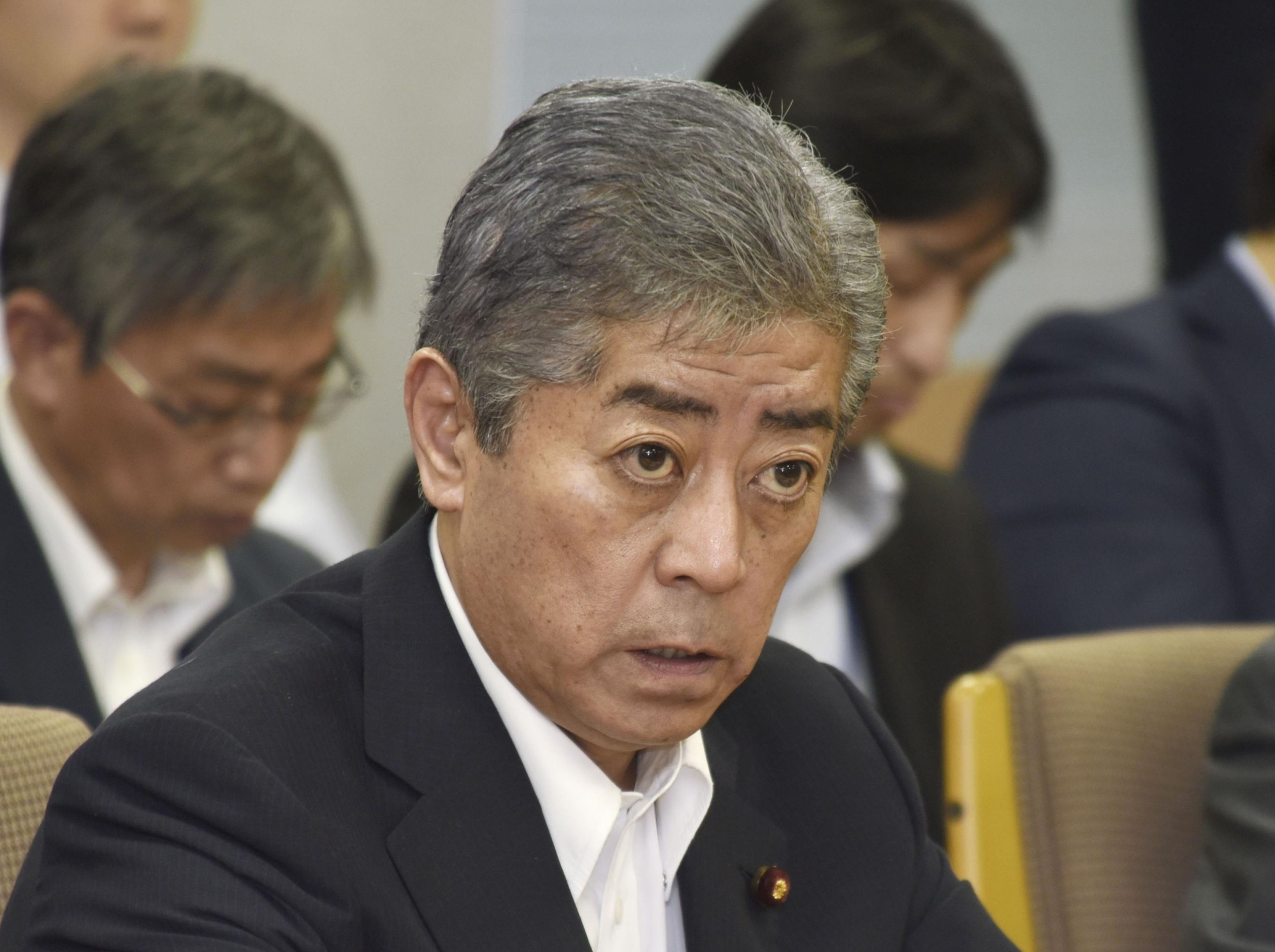 Defense Minister Takeshi Iwaya speaks with local officials in Iwakuni, Yamaguchi Prefecture, on July 2. | KYODO