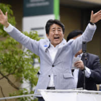Prime Minister Shinzo Abe, who heads the ruling Liberal Democratic Party, waves to supporters on Sunday in Kobe as he stumps for the Upper House election slated for July 21. | KYODO