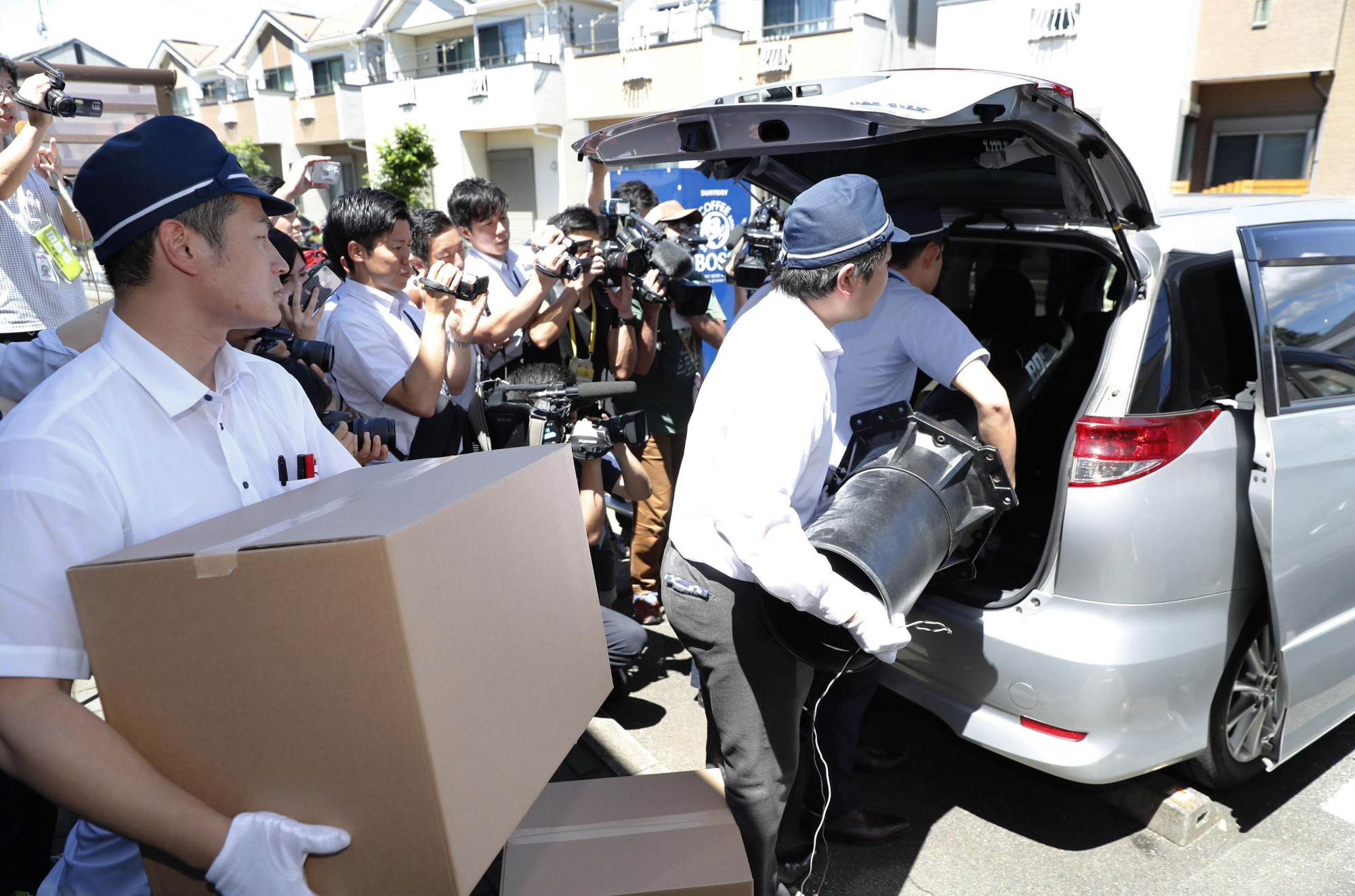 Investigators seize belongings of Kyoto Animation arson attack suspect Shinji Aoba after raiding his house in the city of Saitama on Friday.   KYODO