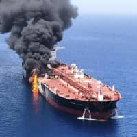 The Japanese-owned Kokuka Courageous oil tanker burns in the Gulf of Oman on June 13 after an attack. | AP / VIA KYODO