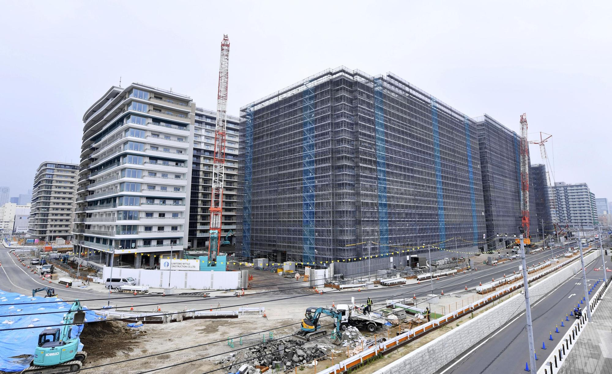 The athletes' village for the Tokyo Olympics and Paralympics is seen under construction in Tokyo's Chuo Ward this month. The building rush before the Olympics is affecting reconstruction efforts in the Tohoku region. | KYODO