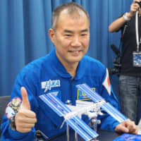 Astronaut Soichi Noguchi will send messages of encouragement from space during torch relays for the 2020 Tokyo Olympics and Paralympics. | KYODO
