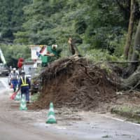 Rains ease in southern Japan but landslide risks persist as death toll rises to two