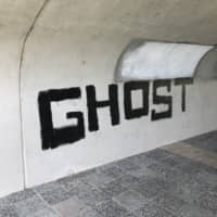 The word 'Ghost' is sprayed on a bridge over the Kamo River in the city of Kyoto in July. | J.J. O'DONOGHUE