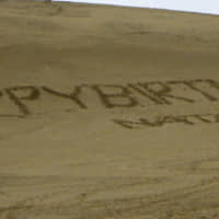 Graffiti shows 'Happy Birthday Natalie' written on a sand dune in the city of Tottori in January. | 