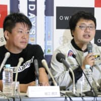 Takafumi Horie (left), founder of Interstellar Technologies Inc., and Takahiro Inagawa, the aerospace startup's president, attend a news conference in Taiki, Hokkaido, on Saturday. | KYODO