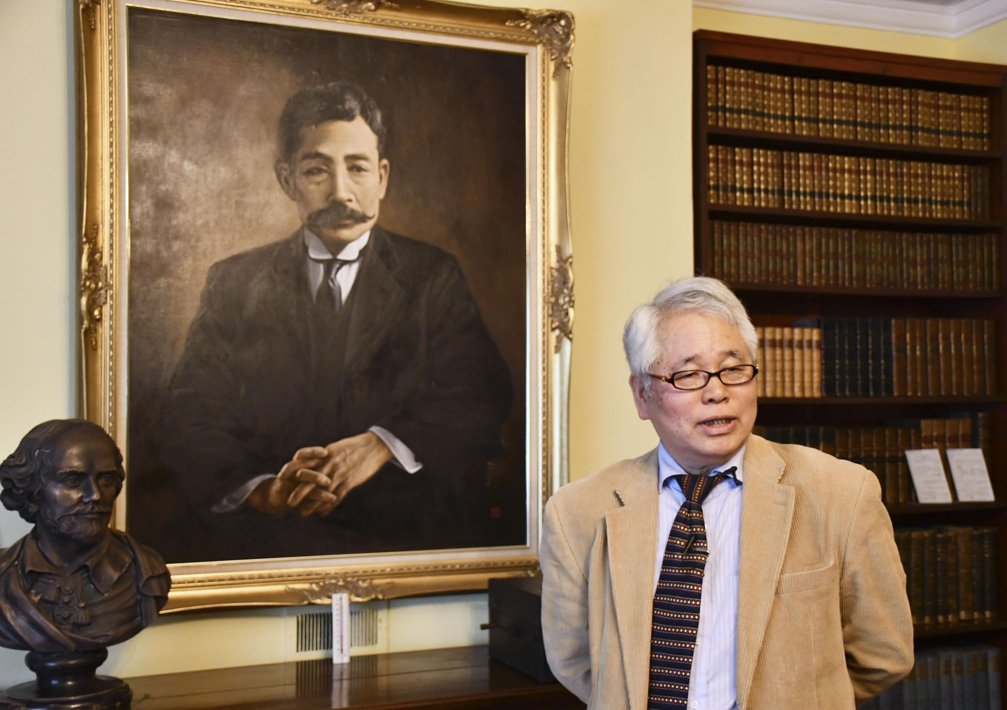 Ikuo Tsunematsu, who runs a museum dedicated to the late novelist Natsume Soseki, speaks at an event for the museum's reopening on May 8. | KYODO